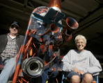"Jeri Priest, right, and her husband Larry Priest (cq) sit in the garage with their ""Bronco..."