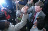 Denver Mayor John Hickenlooper, right, shakes hands with Daniel Betts (cq) at a party for in...