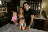Club owner Francois Safieddine (cq), at home with his wife, Catherine and their two kids, Jamil, 7...