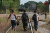 Illegal immigrants walk along the tracks from Chiapas to Veracruz, Mexico, a journey of 150 miles...