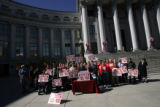 Mason Tvert, front right, held a press conference in front of the City and County Building in...