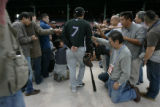 Colorado Rockies, Kazuo Matsui, is surrounded by Japanese media during practice Tuesday Oct. 23,...