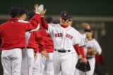 [413] J.D. Drew of the Boston Red Sox high fives a teammate after they beat the Colorado Rockies...