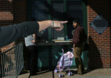 (at left) Sandy Seta (cq), a coordinator for Coors Field points to open ticket booths where a...
