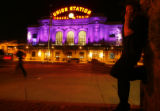 DM1026   Union Station is bathed in purple light behind Eric Brown, a valet at Venice Ristorante...