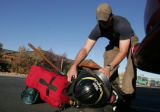 Dustin Searle  (cq) with the Boulder Co Sheriff  Wildland Fire Crew  loads his fighting gear...