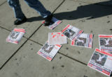 "A pedestrian walks on local Boston newspapers with the headline ""Rockies Horror Show""..."
