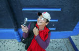 Boston fan Priscilla Kokinis (cq), of Conn., takes a picture of Fenway Park in Boston, Ma., on...