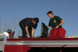 Craig Roberts (cq), left, helps Pat Mulligan (cq), gets his truck ready for departure, Thursday...