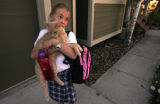 Grace Roberts, 9 picks up her cat 'Bob' after coming back from Lone Tree where she goes to school...