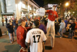 [1180] Colorado Rockies fan Dave Carlson, cq, 46 of Centennial, chats Boston Red Sox fan (who...