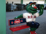 [565] Red Sox Kid Nation, Wally the Green Monster inside Fenway Park in Boston before Game 2 of...