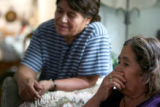 Guadalupe Castilla, cq, 52, and her sister Maria Garcia, cq, 68, (lt-rt), reflect on their...