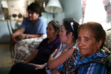 Luciana Garcia, 79, the oldest daughter of Julian Garcia, 100-year-old, stairs out a window,...