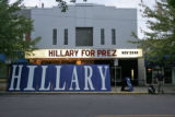 Supporters of U.S. Senator Hillary Clinton (D-NY) stand near signs set up in support across the...