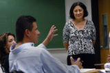 Dr Ruth Chavez listens to her students Alissa Zucker, (cq) (l)  28 and Rodney Y. Sena, (cq) during...