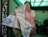 Alicia Garcia (cq) tosses a fabric scrap into her basket as a part of the Ladies Sewing Circle...