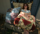 Christine Tuell, (cq) whose sister belongs to the Ladies Sewing Circle of Arvada, rests in a pile...