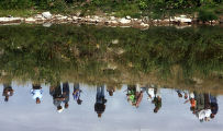 Reflection in the Yampa River of a group of Colorado State Legislators and and water resource and...