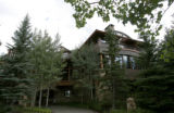 0294 The main house is surrounded by mature Aspen and pine trees at the Hala Ranch which is listed...