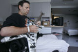 (JOE0700) - Tommy Urbanski strums an electric guitar in his room at Craig Hospital in Denver on...