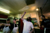At Enzo's End Pizza, Shane Griffin tosses while Scott Taylor (r) Jaimi Robinson (cq) (far left)...