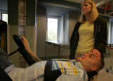 U.S. Army Staff Sgt. Matthew Keil and wife Tracy during a therapy session at Craig Hospital where...