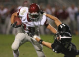 Chatfield's Andy Clements pushes Pomona player Ryan Novotny to the ground on his way to a...