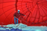 Re/Max Balloon Pilot Russ McLain (cq) during inflation of one of two  Re/Max balloons at  the 8th...
