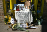 A make-shift memorial sits in front of the door of Mr Tank's Tattoos, Friday morning, August 24,...
