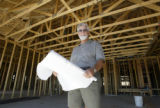 PHOTO BY CHRISTOPHER TOMLINSON--Denny Granum(cq)with Monument Realty in a house under construction...