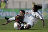Los Angeles Galaxy Gavin Glinton (9) falls over Colorado Rapids Brandon Prideaux (6) during the...