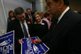 New Mexico Governor Bill Richardson, running for President, signed a poster for James Foy, left,...