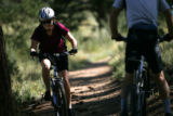 Rosie Chase (cq) of Denver treks up a trail at Centennial Cone Park in Golden, Colo., on Sunday,...