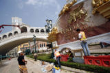 (NYT35) MACAO, China -- Aug. 27, 2007 -- MACAO-GAMBLING-RESORT-2 -- Laborers put the finishing...