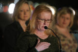 Ginger Thayer (cq, center), mother of Arlene Gavrilis' fiance Adam Hawkes, struggles to contain...