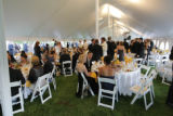 Guests at the 2007 Fete des Fleurs at the Denver Botanic Gardens begin to settle in for dinner on...