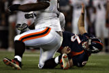 Denver Broncos quarterback Jay Cutler (6) is overturned by Cleveland Browns defensive lineman...