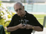 Don Ciancio (cq) mans a phone during the Mary Ciancio Golf/Tennis Tournament, Tuesday morning,...