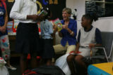 First Lady Jeanne Ritter reacted happily to a new book choice by Milahni Wilkerson, 5, in front of...