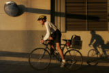 DLM1386  Nancy Severson, 57, leaves from the Wellington Webb Building on her bike after work Wed....