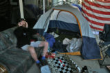 Joe Young (cq), 36, has been camping out since Monday outside of the Sports Authority at 10th and...