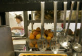 Betty Langston (cq) , 79 works in the kitchen of the Clark Forest Care Center in Arvada August 22,...