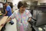 Betty Langston (cq), 79 works in the kitchen of the Clark Forest Care Center in Arvada August 22,...