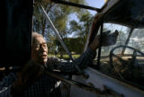 0427 Thomas Atcitty, 78, CQ, tries to open the door of this 1950 Ford dump truck which he and his...