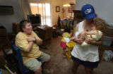 (from left) Jeannie DiClementi (cq) makes gestures to her 2 year-old daughter Evinn...