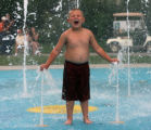 Ivan Underwood, 5,  from Pueblo, cools off while playing in a fountain, Wednesday afternoon,...