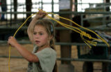 Jordan Lobato, 9, from Center Co., tries her skill with a lasso,   Wednesday afternoon, August 29,...