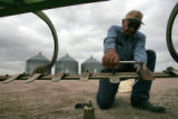 Ivan Linnebur (cq) changes teeth on his rod weeder at his farm in Weld County, near Roggen,...