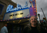 Musician, Greg Boland base player with Jaded Poet stand out in front of the Bluebird Theater...